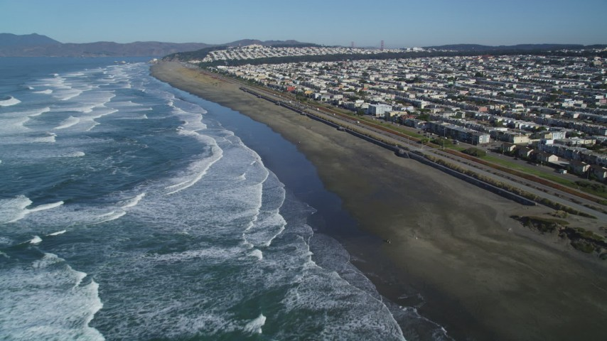 5K stock footage aerial video Fly over Ocean Beach and Great Highway, approach Outer Sunset District, San Francisco, California Aerial Stock Footage | DCSF05_053