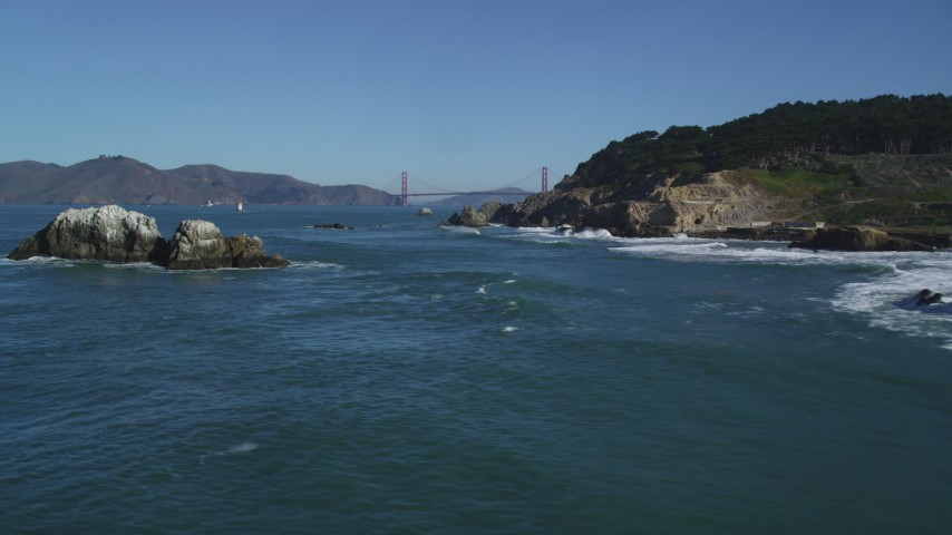 5K stock footage aerial video Approach Seal Rocks, reveal the Golden Gate Bridge, San Francisco, California Aerial Stock Footage | DCSF05_058