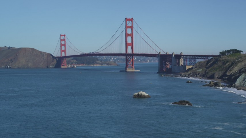 5K stock footage aerial video Tilt up from San Francisco Bay, reveal Golden Gate Bridge, San Francisco, California Aerial Stock Footage | DCSF05_061