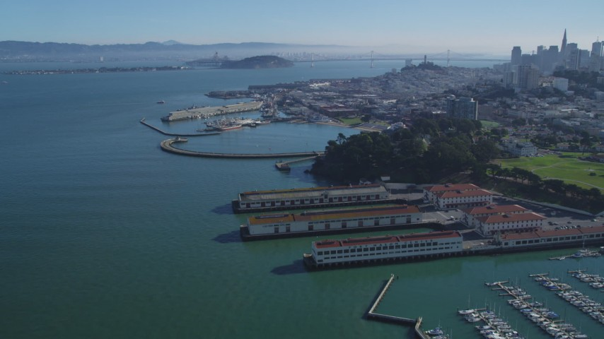 5K stock footage aerial video Fly over Fort Mason, Aquatic Park Pier, approach Fisherman's Wharf, San Francisco, California Aerial Stock Footage | DCSF05_067