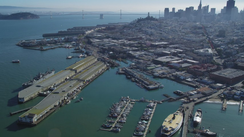 5K stock footage aerial video Flyby Fisherman's Wharf, approach Pier 39, San Francisco, California Aerial Stock Footage | DCSF05_069