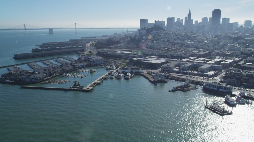 5K stock footage aerial video Flyby Pier 39 and marina, San Francisco skyline in background, San Francisco, California Aerial Stock Footage | DCSF05_070