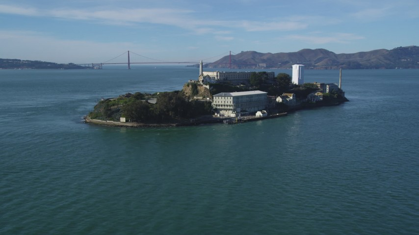 5K aerial video Tilt from low flight over San Francisco Bay, revealing Alcatraz, Golden Gate Bridge, California Aerial Stock Footage | DCSF05_071
