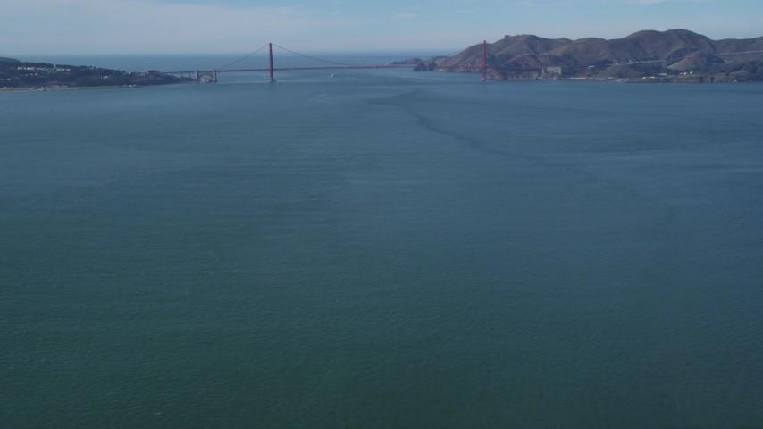 Tilt from low flight over San Francisco Bay, revealing Alcatraz, Golden Gate Bridge, California Aerial Stock Footage | DCSF05_071