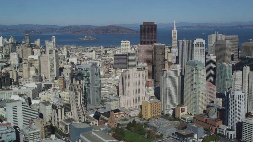 5K stock footage aerial video Flying by Financial District skyscrapers, reveal Coit Tower, San Francisco, California Aerial Stock Footage | DCSF05_074