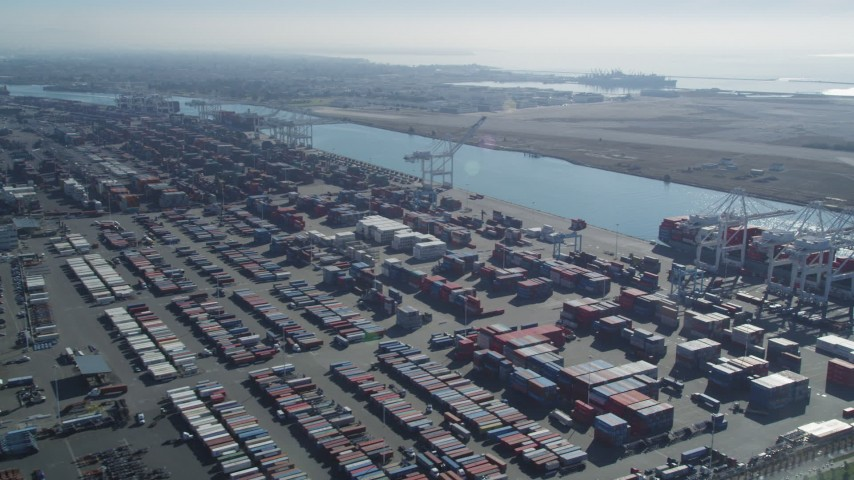 5K stock footage aerial video Flyby cargo containers to ships docked under cranes, Port of Oakland, Oakland, California Aerial Stock Footage | DCSF05_076