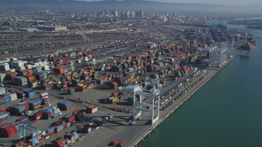 5K stock footage aerial video Flying by cargo cranes, and stacks of shipping containers, Port of Oakland, Oakland, California Aerial Stock Footage | DCSF05_077
