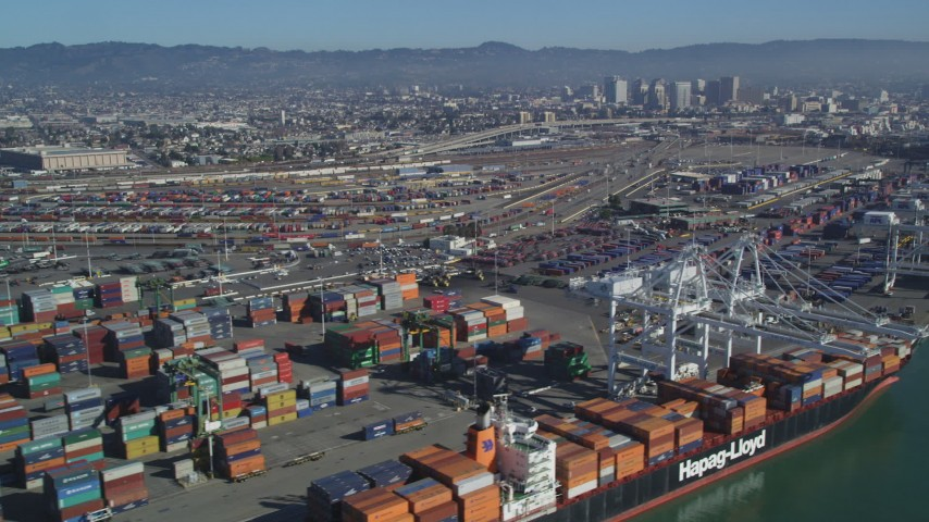 5K stock footage aerial video Flying by cargo cranes, shipping containers, cargo ships, Port of Oakland, Oakland, California Aerial Stock Footage | DCSF05_078