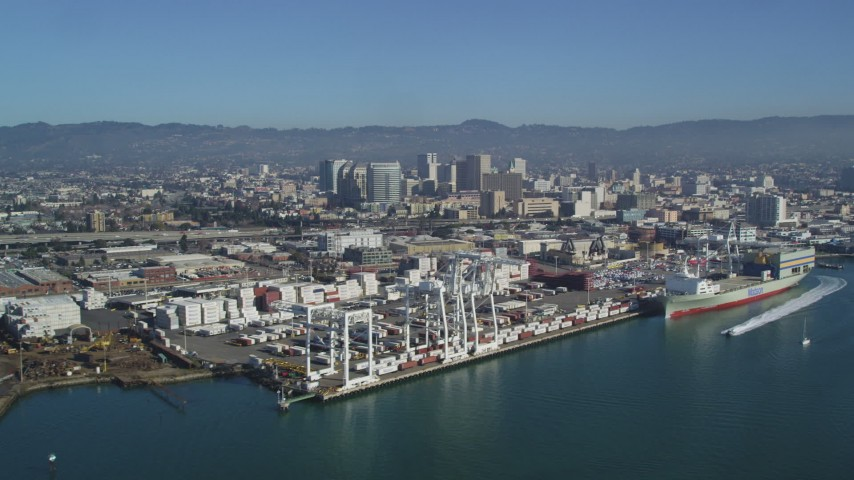 5K stock footage aerial video Flying by Port of Oakland Inner Harbor, Downtown Oakland in the background, California Aerial Stock Footage | DCSF05_080