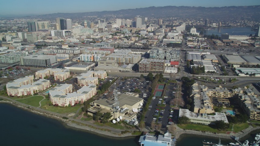 5K stock footage aerial video Flyby waterfront apartment buildings, marinas, KTVU Television/FOX 2 building, Oakland, California Aerial Stock Footage | DCSF05_081