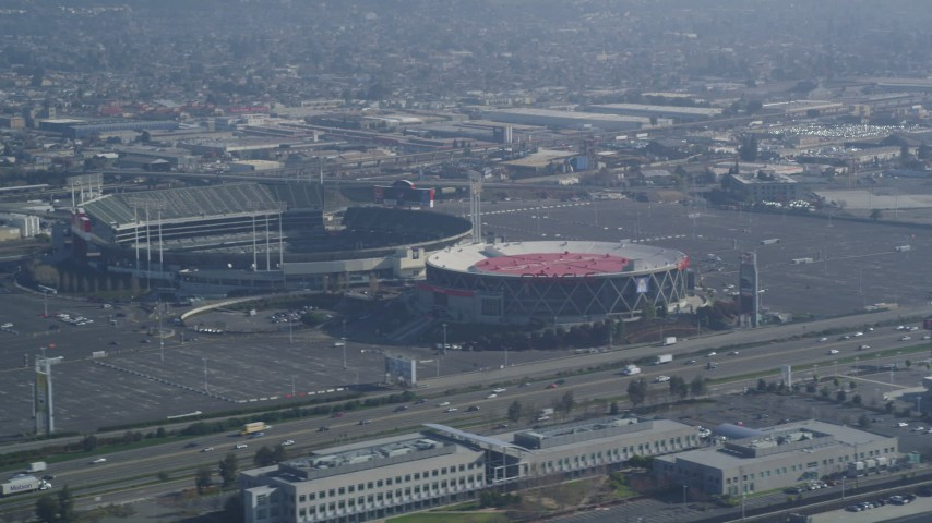 5K stock footage aerial video Flying by O.co Coliseum and the Oracle Arena, Oakland, California Aerial Stock Footage | DCSF05_082