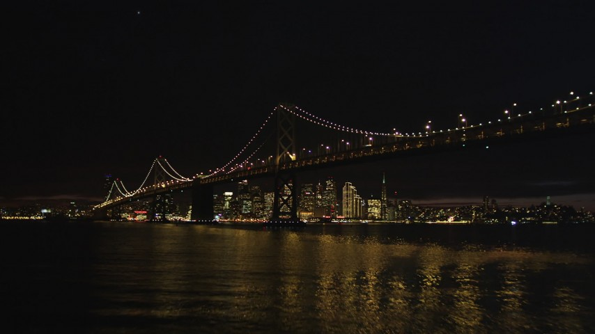 5K stock footage aerial video Approach and fly over Bay Bridge, approach Downtown San Francisco skyline, California, night Aerial Stock Footage | DCSF06_002
