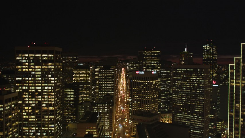 5K stock footage aerial video Follow Market Street between skyscrapers, Downtown San Francisco, California, night Aerial Stock Footage | DCSF06_005