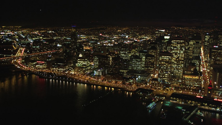 5K aerial video Reverse view pan across the Downtown San Francisco cityscape, California, night Aerial Stock Footage | DCSF06_011