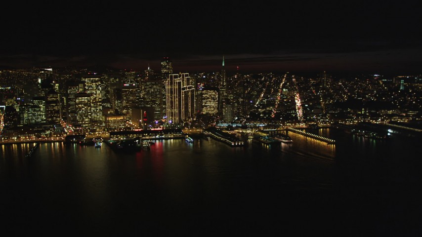 5K stock footage aerial video Flying away from Downtown San Francisco, California, at night, seen from San Francisco Bay Aerial Stock Footage | DCSF06_012