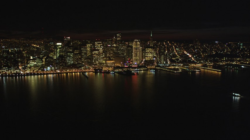 5K stock footage aerial video Flyby the Downtown San Francisco skyline, revealing Bay Bridge, California, night Aerial Stock Footage | DCSF06_013