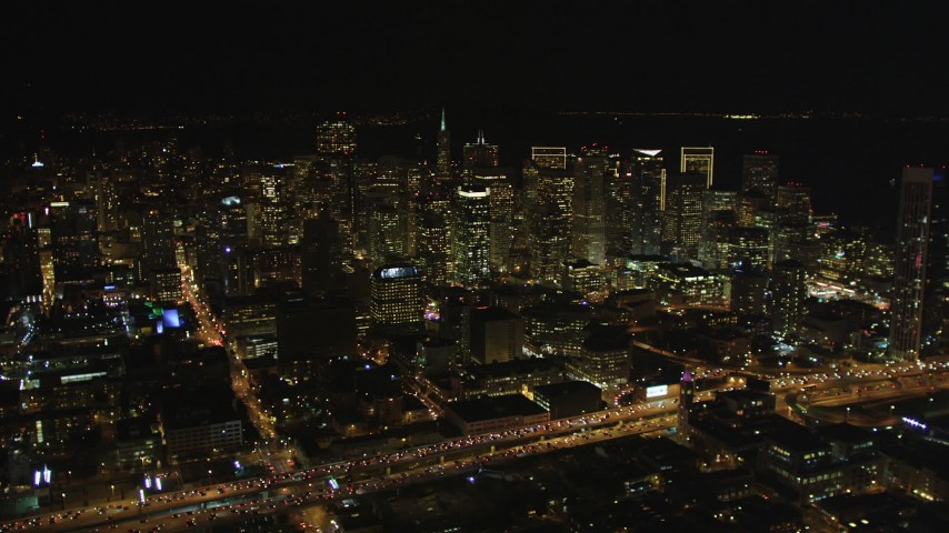 5K stock footage aerial video Approach Downtown San Francisco from South of Market, California, night Aerial Stock Footage | DCSF06_020