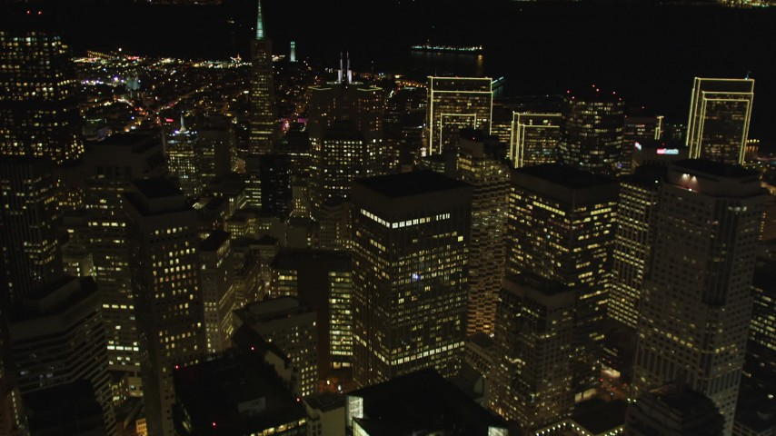 5K stock footage aerial video Tilt from busy streets to reveal skyscrapers and Transamerica Pyramid, Downtown San Francisco, California, night Aerial Stock Footage | DCSF06_021