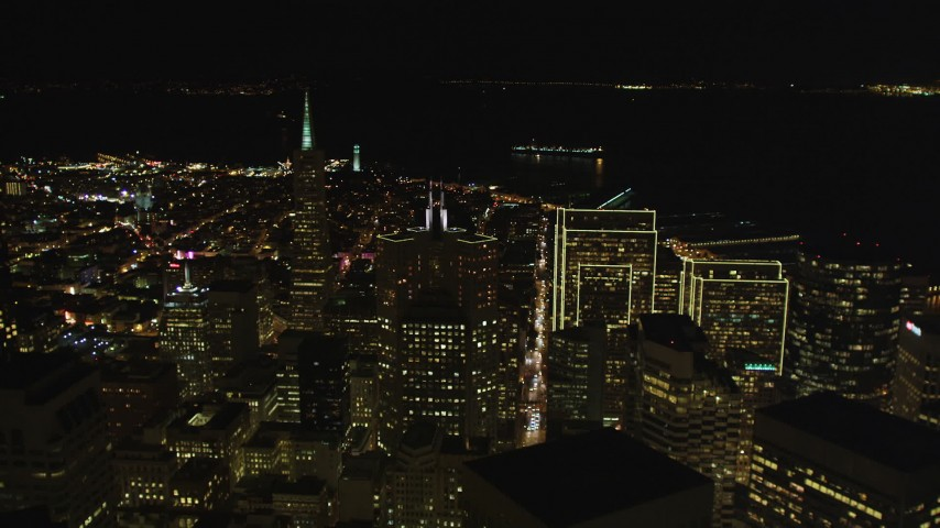 5K stock footage aerial video Fly over Financial District, approach Transamerica Pyramid and Coit Tower, San Francisco, California, night Aerial Stock Footage | DCSF06_022