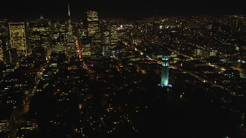 5K stock footage aerial video Flying by Coit Tower with a view of Transamerica Pyramid, San Francisco, California, night Aerial Stock Footage | DCSF06_025