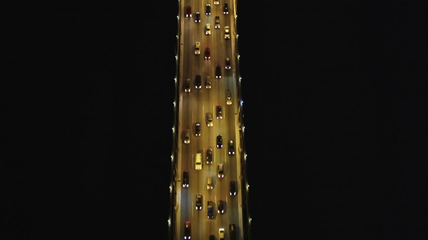 5K stock footage aerial video Bird's eye view of traffic on the Bay Bridge, San Francisco, California, night Aerial Stock Footage | DCSF06_027