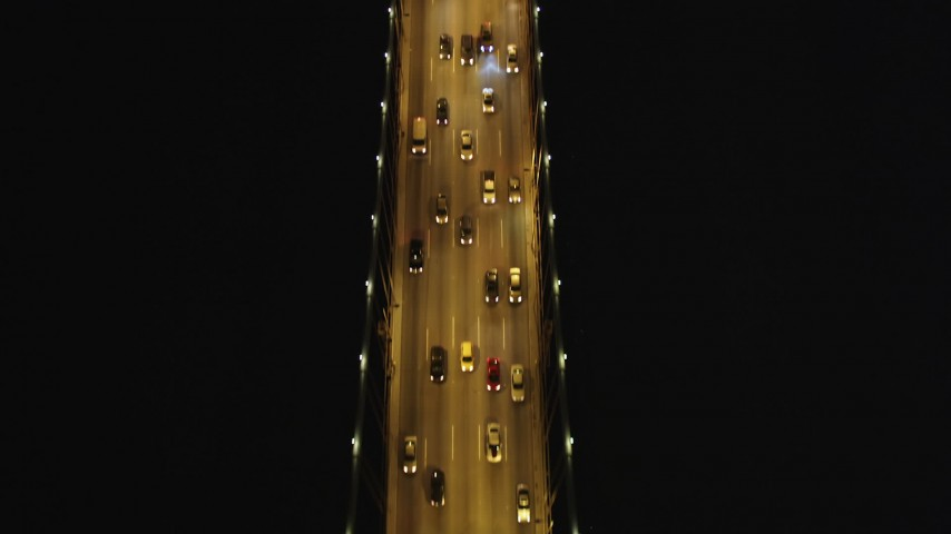 5K aerial video Bird's eye flying over Bay Bridge, San Francisco, California, night Aerial Stock Footage | DCSF06_029