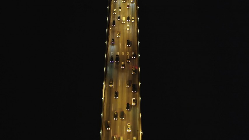 5K stock footage aerial video Tilt from bird's eye of Bay Bridge, reveal cargo ship, San Francisco, California, night  Aerial Stock Footage | DCSF06_030