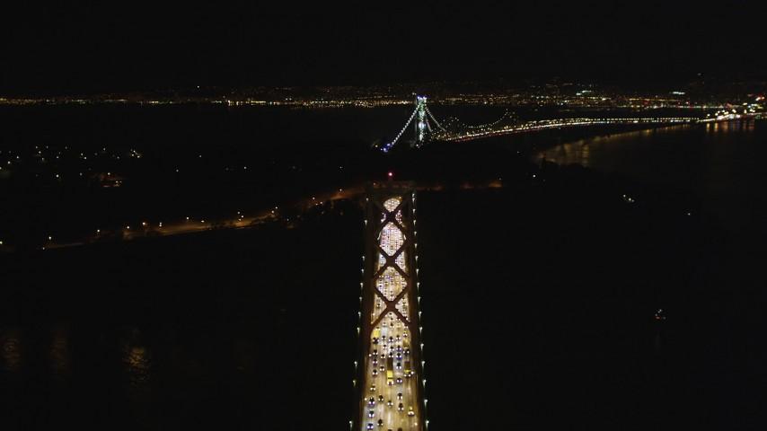 5K stock footage aerial video Follow Bay Bridge, approach Yerba Buena Island, San Francisco, California, night Aerial Stock Footage | DCSF06_031