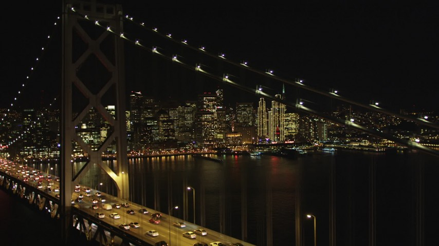 5K aerial video Focus on Downtown San Francisco skyline and fly over Bay Bridge, California, night  Aerial Stock Footage | DCSF06_036