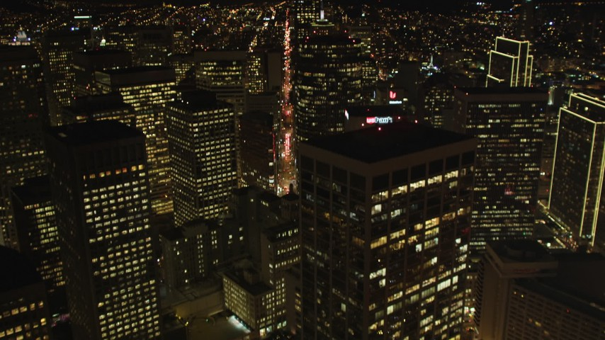 5K stock footage aerial video Tilt from The Embarcadero, reveal Downtown San Francisco skyscrapers, California, night Aerial Stock Footage | DCSF06_037