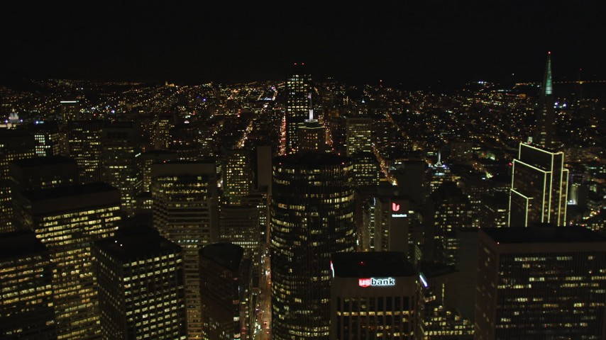 5K stock footage aerial video Flying over high-rises and skyscrapers in Downtown San Francisco, California, night Aerial Stock Footage | DCSF06_038