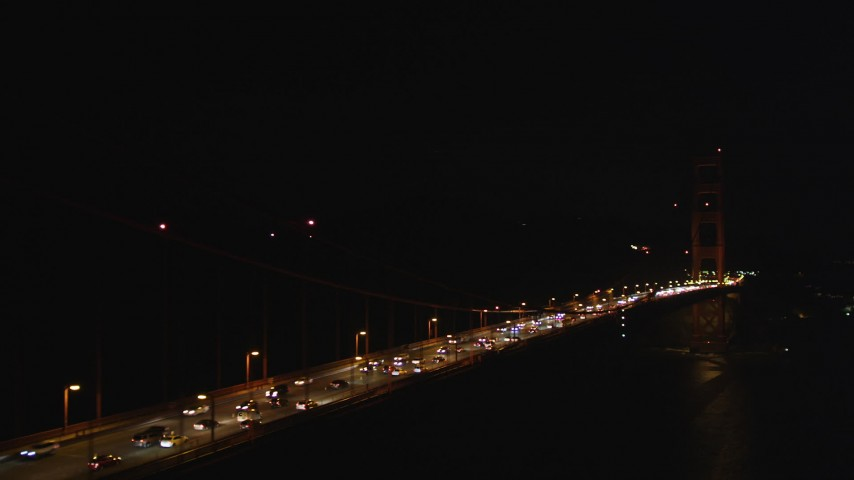 5K stock footage aerial video Flying by the Golden Gate Bridge with light traffic, San Francisco, California, night Aerial Stock Footage | DCSF06_042