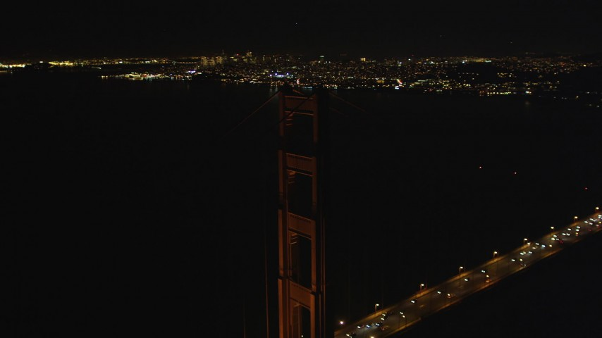 5K stock footage aerial video Flying by one of the Golden Gate Bridge towers, San Francisco, California, night Aerial Stock Footage | DCSF06_044