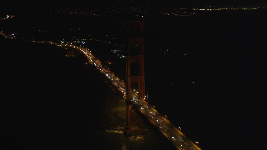 5K stock footage aerial video Orbit a tower of the Golden Gate Bridge, San Francisco, California, night Aerial Stock Footage | DCSF06_046