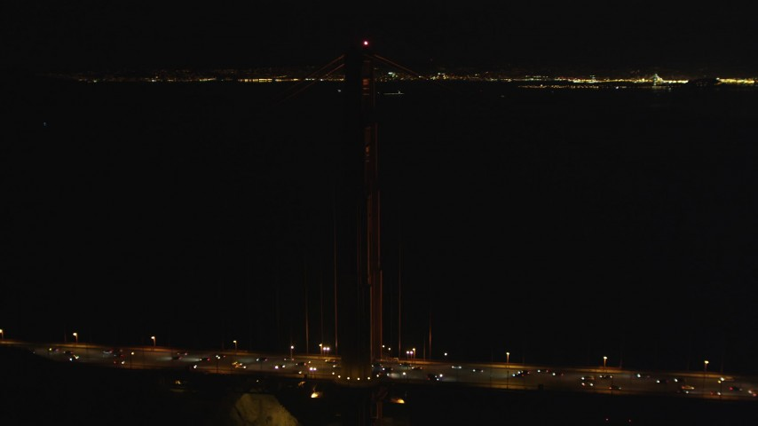 5K aerial video Orbit of a tower on the Golden Gate Bridge, San Francisco, California, night Aerial Stock Footage | DCSF06_047