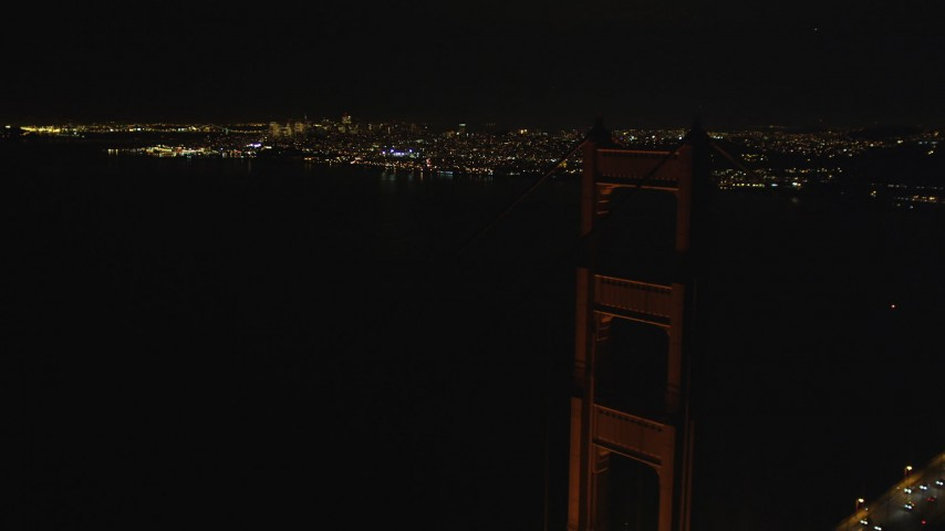 5K stock footage aerial video Orbiting a tower on the Golden Gate Bridge, San Francisco, California, night Aerial Stock Footage | DCSF06_048