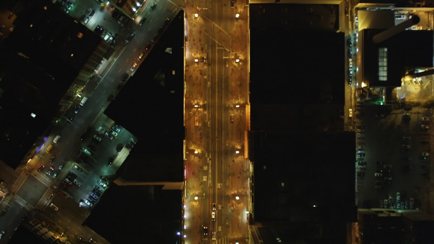 5K aerial video Bird's eye of light traffic on Market Street, cross streets, Downtown San Francisco, California, night Aerial Stock Footage | DCSF06_057