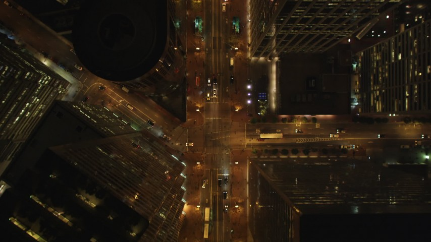 5K stock footage aerial video of A bird's eye view of Market Street through Downtown San Francisco, California, night Aerial Stock Footage | DCSF06_061