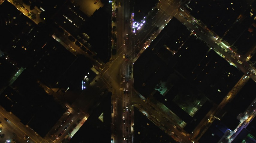 5K stock footage aerial video Bird's eye view of Columbus Avenue, North Beach, San Francisco, California, night Aerial Stock Footage DCSF06_066 | Axiom Images