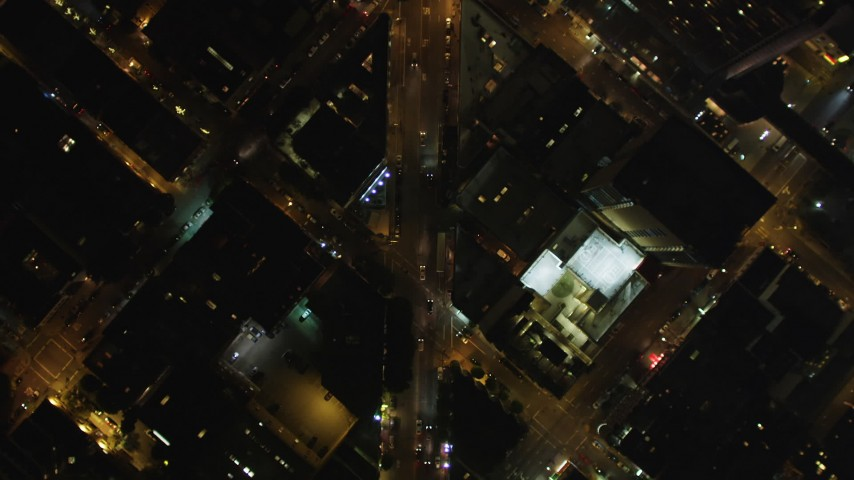5K stock footage aerial video Bird's eye view of Columbus Avenue, reveal Transamerica Pyramid, Downtown San Francisco, California, night Aerial Stock Footage | DCSF06_067