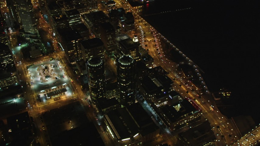 5K stock footage aerial video Orbit Infinity Towers condominiums, tilt to reveal Downtown San Francisco, California, night Aerial Stock Footage | DCSF06_069