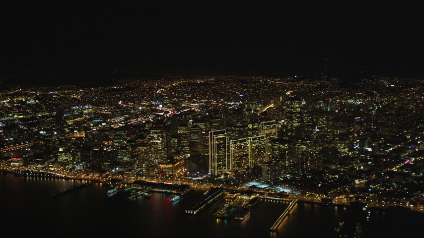 5K stock footage aerial video High altitude view of Downtown San Francisco, California, seen from San Francisco Bay at night Aerial Stock Footage | DCSF06_071