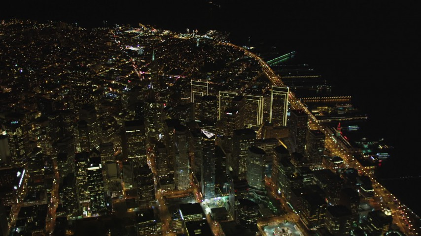 5K stock footage aerial video Tilt up from The Embarcadero to reveal I-80 and Downtown San Francisco, California, night Aerial Stock Footage | DCSF06_077