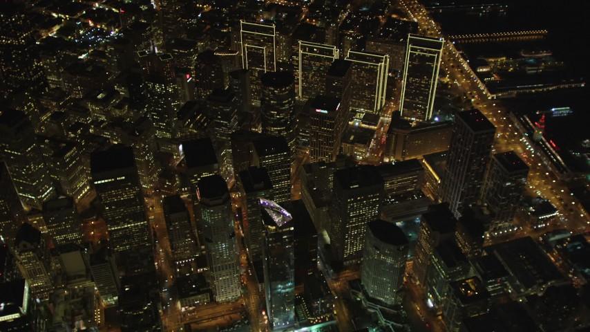 5K stock footage aerial video Tilt to bird's eye view of downtown skyscrapers around Market Street, San Francisco, California, night Aerial Stock Footage | DCSF06_079