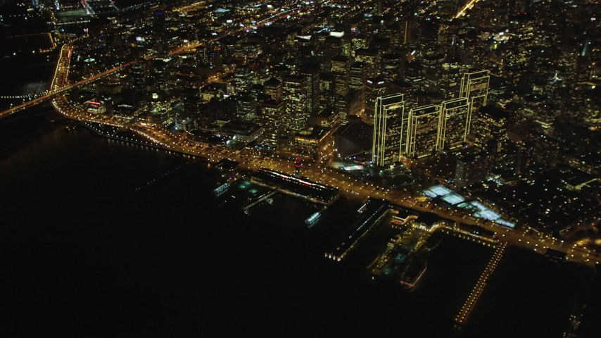 5K stock footage aerial video High altitude view of Ferry Building, Downtown San Francisco, California, night Aerial Stock Footage | DCSF06_081