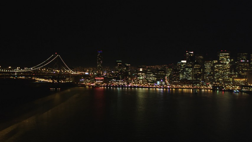 5K stock footage aerial video Reverse view of the Bay Bridge, San Francisco, California, night Aerial Stock Footage | DCSF06_084