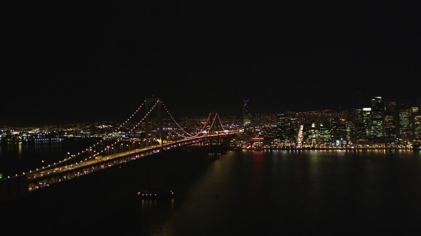 5K stock footage aerial video Flying away from the Bay Bridge, San Francisco, California, night Aerial Stock Footage | DCSF06_085