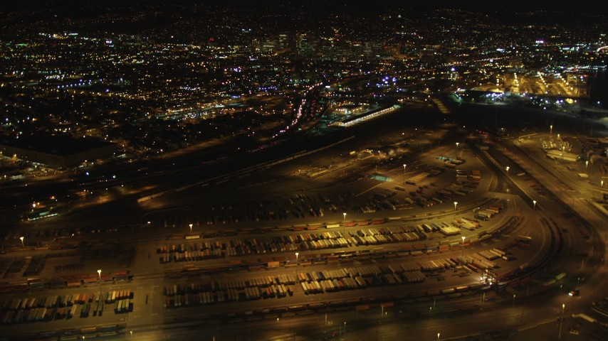 5K stock footage aerial video Tilt from Port of Oakland to reveal I-880 and Downtown Oakland, California, night Aerial Stock Footage | DCSF06_089