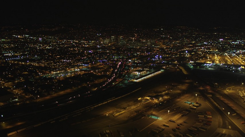 5K stock footage aerial video Approach Interstate 880 and Downtown Oakland, California, night Aerial Stock Footage | DCSF06_090
