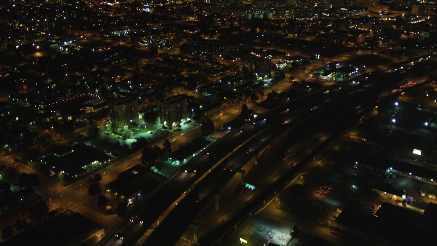5K stock footage aerial video Tilt from light traffic on Interstate 880, revealing Downtown Oakland, California, night Aerial Stock Footage | DCSF06_091